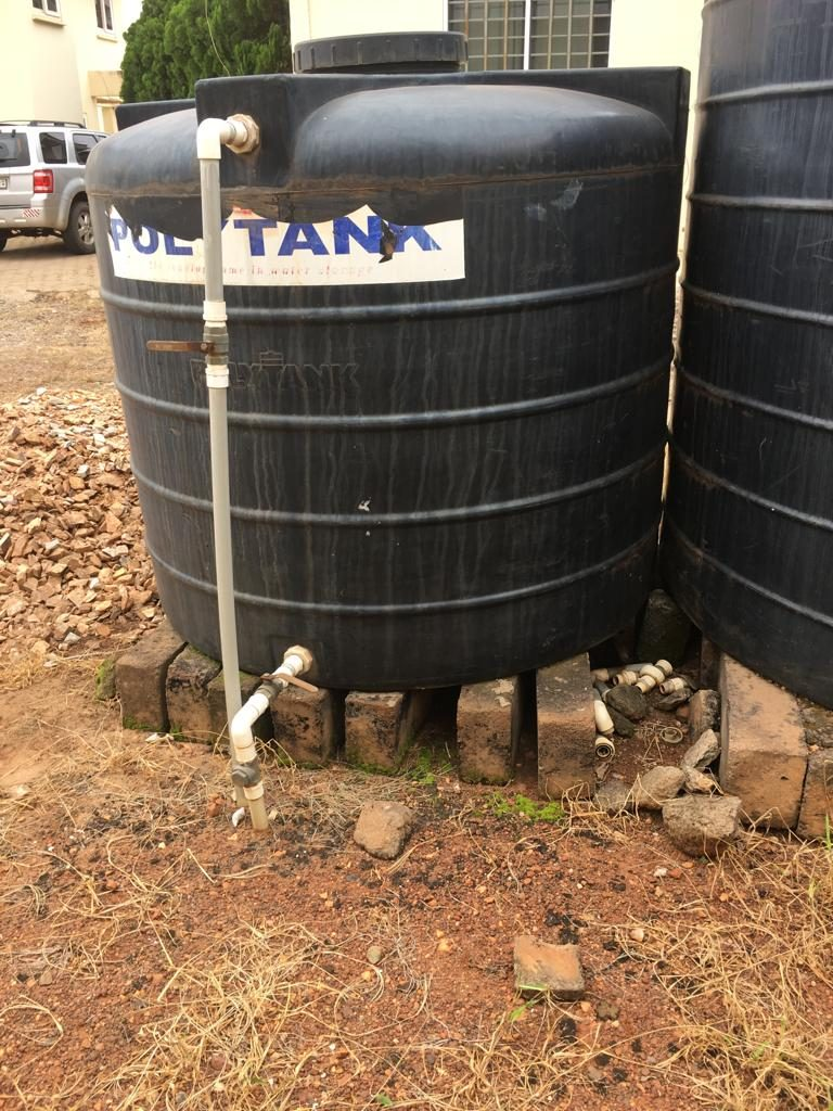 Badly placed water storage tank on bricks